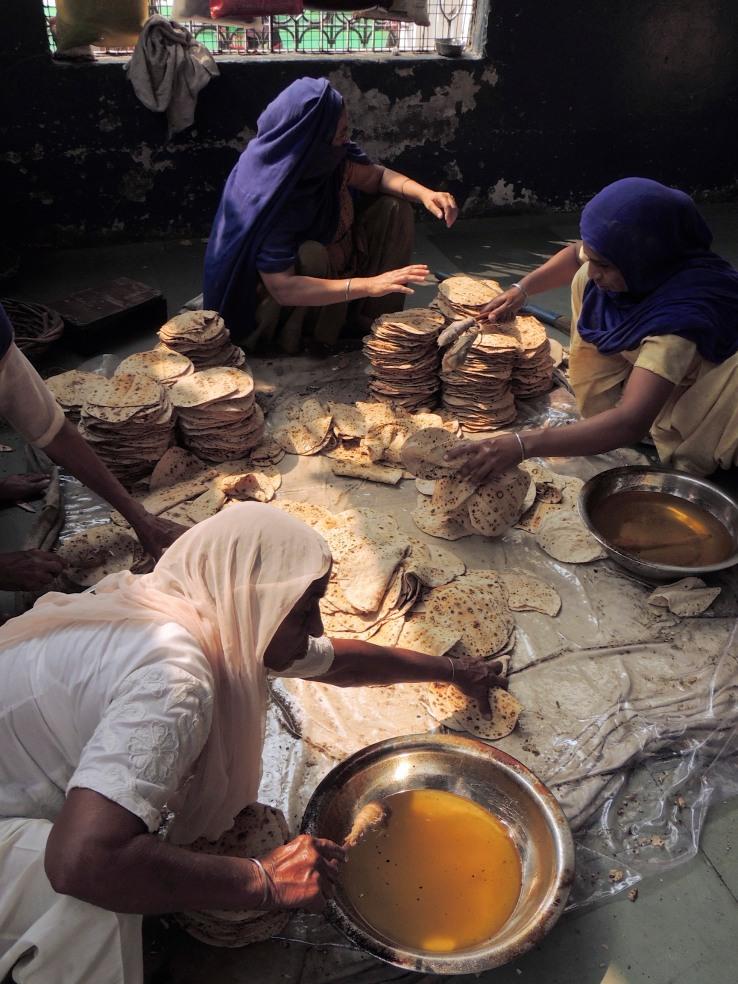 Volunteers Buttering Indian Bread