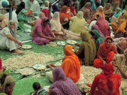 Volunteers Peeling Garlic