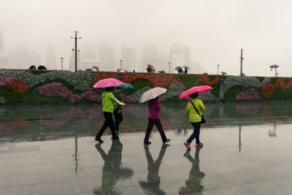 Pictures of The Bund in the Rain in Shanghai China with BJ Adventures trip by mcmessner Mary Catherine Messner
