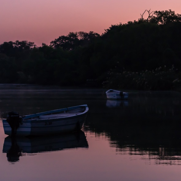 Picture of morning light on boats on Zambezi River, Zambia, Africa while on the 2016 Passport to Folk Art: South Africa trip with BJ Adventures