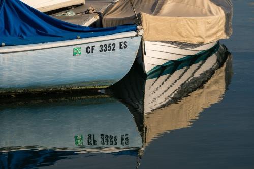 Picture of nautical boat reflections from Balboa Island on Newport Bay, Newport Beach, California, USA.
