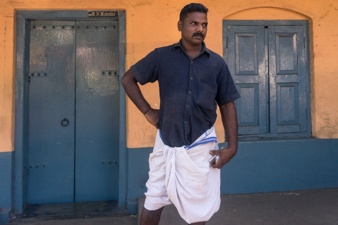 Street photography portrait of man in Thrissur, Kerala, India on workshop with Maciej Dakowicz by mcmessner Mary Catherine Messner