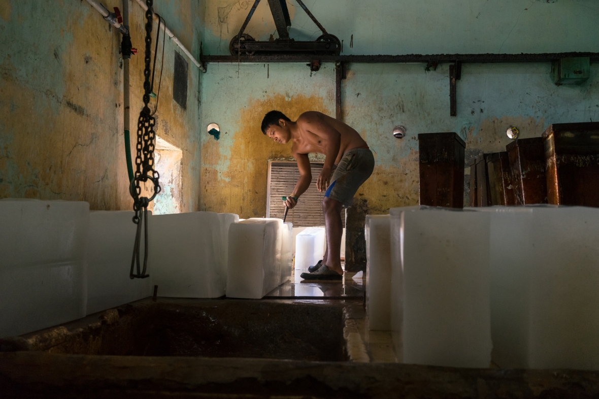 Photography of worker in ice factory in Cochin, Kerala, India by Mary Catherine Messner mcmessner