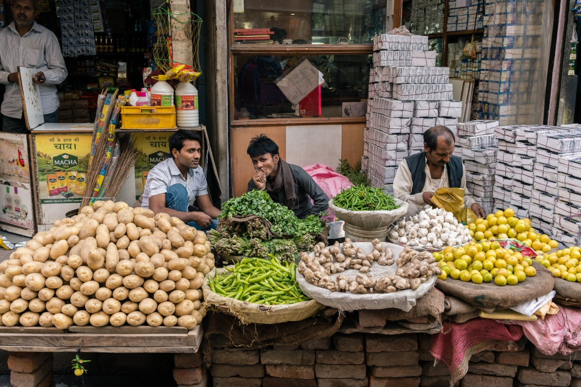 Travel and street photography of vegetable market vendors in Delhi, India taken while Walking the Lanes by Mary Catherine Messner mcmessner with Maciej Dakowicz