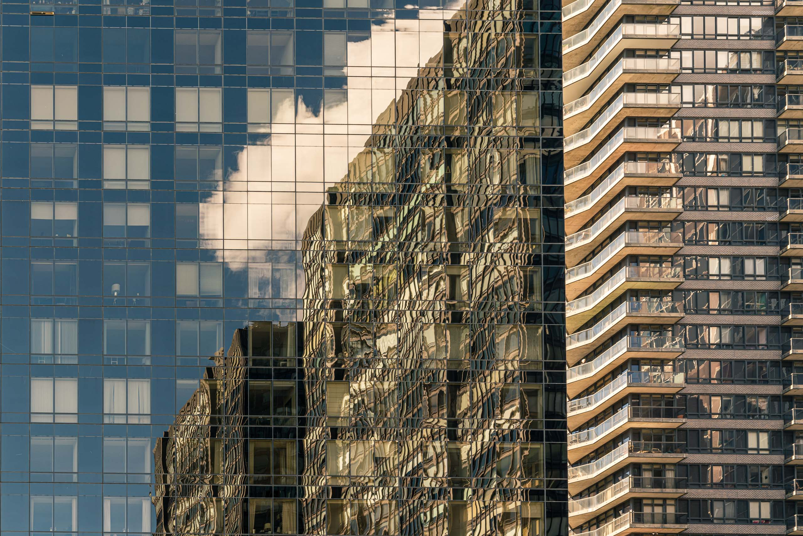 Travel and street photography of architectural reflections of clouds found in New York City USA made by New York photographer Mary Catherine Messner (mcmessner).