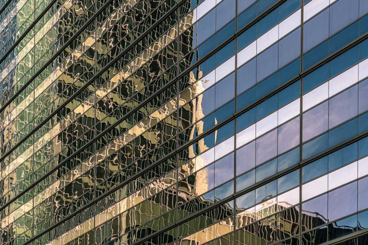 Travel and street photography of the architectural reflections found in New York City USA made by New York photographer Mary Catherine Messner (mcmessner).